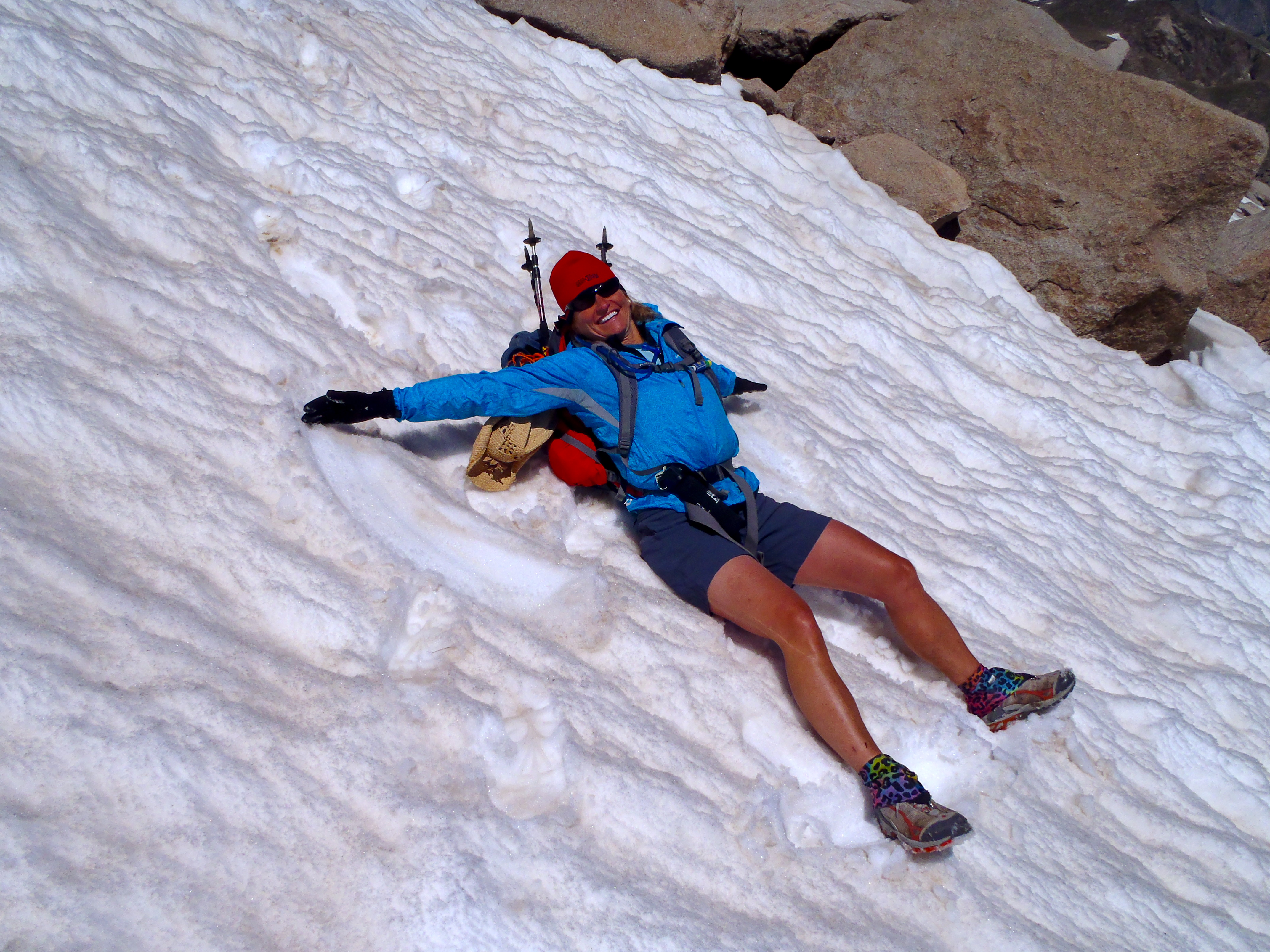 Doing an (awkward backpack-bearing) snow angel on our way down.