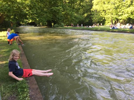 Fin dips in his toes in the water in Englischer Garten.