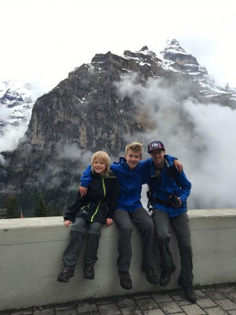 Our boys, sitting in front of Jungfrau in Mürren.