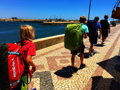 The boys, with their heavy Patagonia Black Hole backpacks on, on our mile-and-a-half, uphill walk to our apartment near the beach.