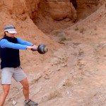 Doing some kettlebell swings during some down time in Goblin Valley.