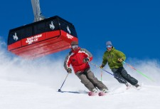 Skiers Bill Lewkowitz and Lisa Walker enjoy a run. That's the Tram in the background. (Tristan Greszko/JHMR photo)