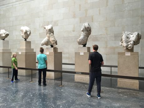 The boys, admiring some of the Elgin Marbles, in the British Museum.
