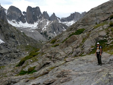 Kathy on Jackass Pass, with the prize--the Cirque of the Towers--showing themselves.