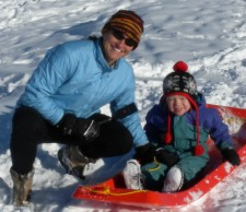 Sledding with our youngest son, 2-year-old Finis.