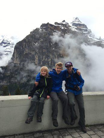 Our boys, sitting in front of Jungfrau in Mürren.