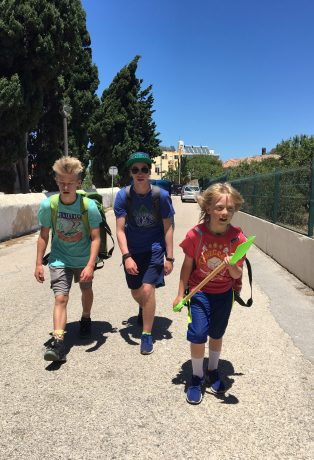The boys leaning in during the final half mile of our walk to our beach apartment.