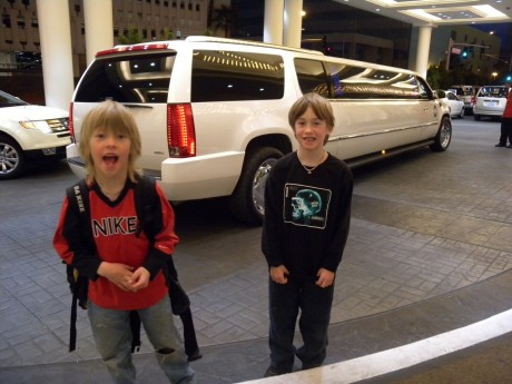 Hayden and Wolfie posing in front of some famous person's ride. (Every time they saw a stretch they were certain it was Miley Cyrus or Zac Efron!)